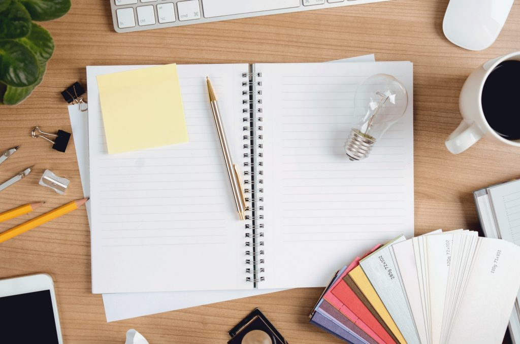 Creative Workplace With Designer Items, Light Bulb and Blank Memo Sticker
